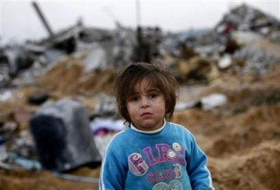 A Palestinian girl stands amongst the ruins of destroyed houses on the outskirts of Jabalya in the northern Gaza Strip