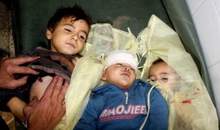 Children from the Samouni family lie in the morgue in the al-Zeitoun area of Gaza City. (Mohamed Al-Zanon/MaanImages)
