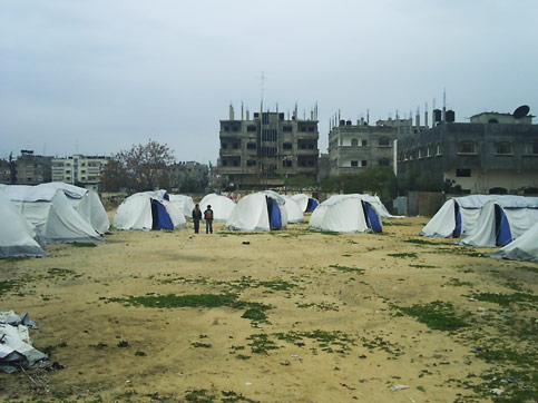Tents setup in the al-Rayyan refugee camp for Palestinians whose homes were destroyed by the Israeli attacks on Gaza. (Rami Almeghari)