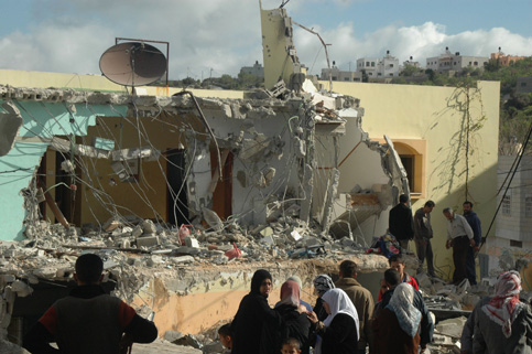 Palestinians inspect the house of a Palestinian fighter after it was demolished by Israeli troops during a military operation in the West Bank town of Sedia near Tulkarem, March 2008. (Mouid Ashqar/MaanImages)