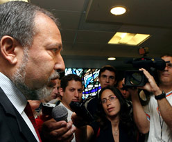 Foreign Minister Avigdor Lieberman speaking to the media Sunday before the weekly cabinet meeting in Jerusalem. (Reuters)