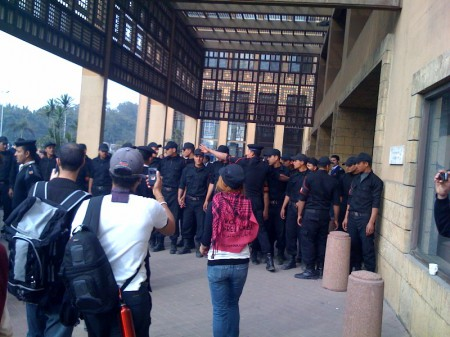 Marchers Marchers facing hundreds of police at the UN building in Cairo, photo by Ali Abunimah